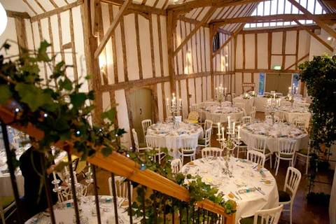 internal photo of a dove barn set up for wedding reception