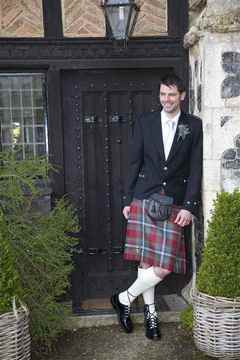 Groom outside Butley Priory