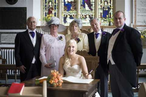 The bride and groom with family at Aldeburgh Parish Church