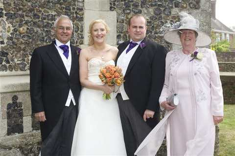 The bride and groom with parents at Aldeburgh Parish Church, Suffolk