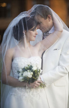 Romantic wedding photograph of bride and groom