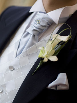 detail of the wedding suit and cravat