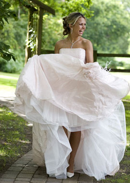 bride wearing wedding gown from tinkerbelle