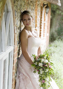 photo of a bride by the shepherd's cottage